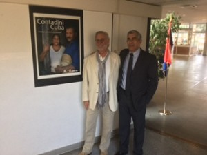 UA photographer Chip Cooper with Cuban photographer Julio Larramendi at their exposition in Rome.