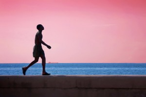 Boy Walking on Malecon Wall